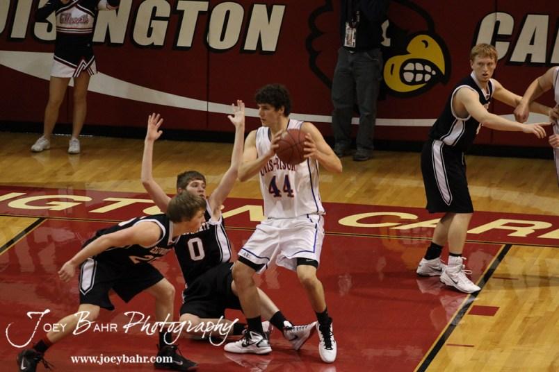 Ellsworth Bearcats Matthew Keener (#0) falls to the floor while Otis-Bison Cougar Brandon Pechanec (#44) moves towards the basket at the 2012 Hoisington Winter Jam Basketball Tournament.