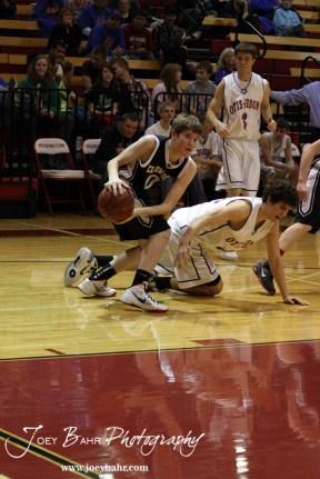 Ellsworth Bearcat Matthew Keener (#0) steals the ball from Otis-Bison Cougar Brandon Pechanec (#44) during the 2012 Hoisington Winter Jam Basketball Tournament.