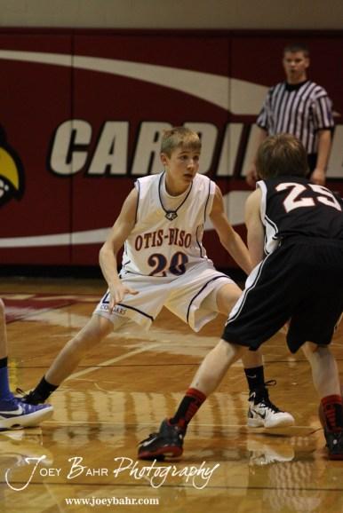 Otis-Bison Cougar Colin Regan (#20) tries to defend Ellsworth Bearcat Grant Glaser (#25) at the 2012 Hoisington Winter Jam Basketball Tournament.