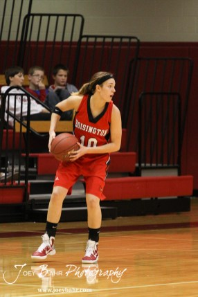 Jordin Greer (#10) of the Hoisington Lady Cardinals looks to make a pass to a teammate against the Russell Lady Broncos at the 2012 Hoisington Winter Jam Basketball Tournament.