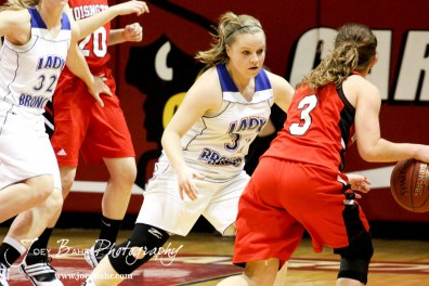 Tori Ptacek (#31) of the Russell Lady Broncos defends against Hoisington Lady Cardinal Mykela Riedl (#3) at the 2012 Hoisington Winter Jam Basketball Tournament.