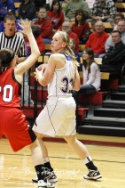 Russell Lady Bronco Janna Schulte (#32) looks to make a pass against the Hoisington Lady Cardinals at the 2012 Hoisington Winter Jam Basketball Tournament.