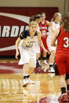 Madison Beagley (#12) of the Russell Lady Broncos prepares to defend Hoisington Lady Cardinal Mykela Riedl (#3) at the 2012 Hoisington Winter Jam Basketball Tournament.