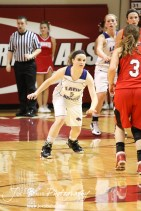 Russell Lady Bronco Alex Ptacek (#5) lines up to defend Mykela Riedl (#3) of the Hoisington Lady Cardinals at the 2012 Hoisington Winter Jam Basketball Tournament.