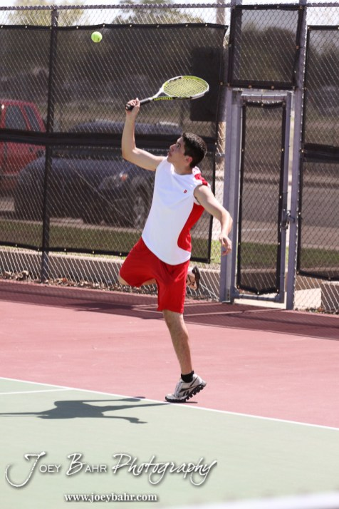 A Liberal player serves the ball during the Great Bend Invitiational Boys Tennis Tournament at Great Bend High School in Great Bend, Kansas on March 31, 2012. (Photo: Joey Bahr, www.joeybahr.com)