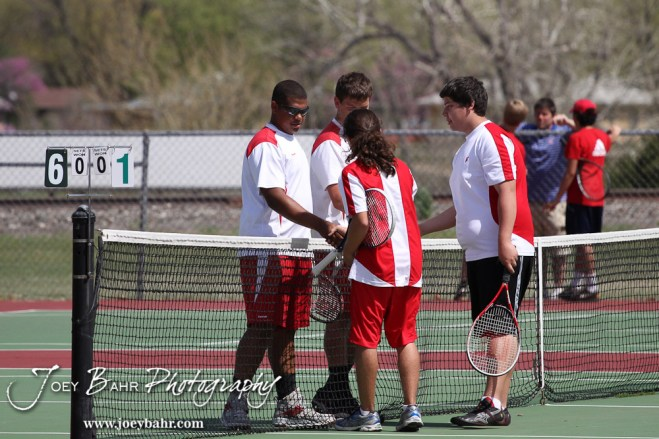 Hoisington and Liberal players shake hands after their match at the Great Bend Invitiational Boys Tennis Tournament at Great Bend High School in Great Bend, Kansas on March 31, 2012. (Photo: Joey Bahr, www.joeybahr.com)
