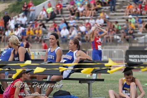 Teresa Wade of St. John-Hudson and Janel Tammen of Otis-Bison chat while waiting for their Class 1A Girls Shot Put medals during the 2012 KSHSAA State Track and Field Championship at Cessna Stadium on the campus of Wichita State University in Wichita, Kansas on May 25, 2012. (Photo: Joey Bahr, www.joeybahr.com)