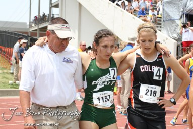 An official and Colby's Emilea Finley help Cheyenne Becker off the track after the Class 4A Girls 1600 Meter Run during the 2012 KSHSAA State Track and Field Championship at Cessna Stadium on the campus of Wichita State University in Wichita, Kansas on May 26, 2012. (Photo: Joey Bahr, www.joeybahr.com)