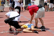 Athletic Trainers help Maddie Hopfinger of St. Thomas Aquinas after the Class 5A Girls 1600 Meter Run during the 2012 KSHSAA State Track and Field Championship at Cessna Stadium on the campus of Wichita State University in Wichita, Kansas on May 26, 2012. (Photo: Joey Bahr, www.joeybahr.com)