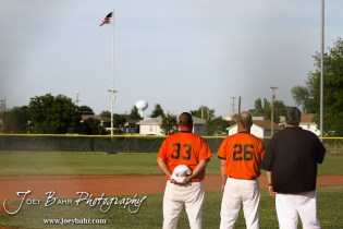 The coaches for the Colby Eagles watch the American Flag during the National Anthem before their game against the Nickerson Panthers at the KSHSAA 4A Regional Baseball Championship at Legion Field in Hoisington, Kansas on May 16, 2012. (Photo: Joey Bahr, www.joeybahr.com)