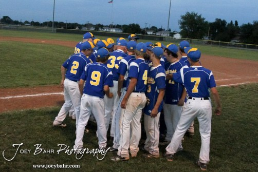 Nickerson Panthers huddle up to celebrate their 4-1 victory over the Colby Eagles at the KSHSAA 4A Regional Baseball Championship at Legion Field in Hoisington, Kansas on May 16, 2012. (Photo: Joey Bahr, www.joeybahr.com)
