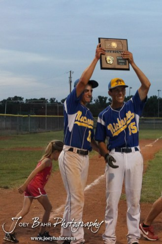 Nickerson Panther Seniors Quintin Crandall (#11) and Justin Engelland (#15) hold up the 4A Regional Baseball Championship plaque after their 4-1 victory over the Colby Eagles at the KSHSAA 4A Regional Baseball Championship at Legion Field in Hoisington, Kansas on May 16, 2012. (Photo: Joey Bahr, www.joeybahr.com)
