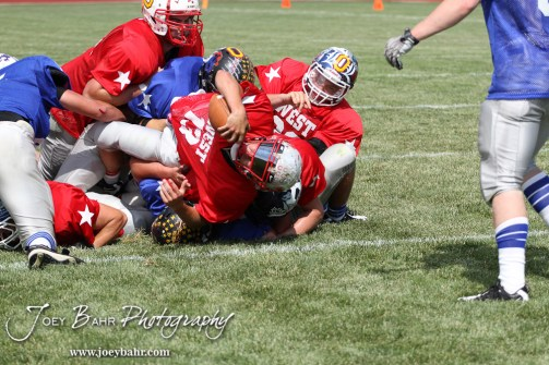 West All-Star Seth Filbert of Macksville High School (#13) stretches for a two point conversion against the East All-Stars during the Kansas Eight Man Football Association Division I All-Star Game at Trojan Field in Beloit, Kansas on June 9, 2012. (Photo: Joey Bahr, www.joeybahr.com)