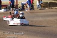Tyler Walker(#20) and Cooper Shubert(#7X) race in Heat 1 of the Junior 2 Light Class at the Ness County Speedway Kart Races sponsored by Walker Tank Service at Ness County Speedway in Ness City, Kansas on August 18, 2012. (Photo: Joey Bahr, www.joeybahr.com)