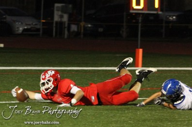 McPherson Bullpup Keaton Sorenson (#4) stretches out for a touchdown during the Winfield at McPherson football game that ended in a 47 to 8 victory for the Bullpups at the McPherson Stadium in McPherson, Kansas on September 28, 2012. (Photo: Joey Bahr, www.joeybahr.com)
