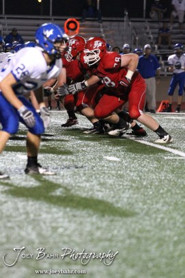 The McPherson Bullpups Offensive Line blocks during the Winfield at McPherson football game that ended in a 47 to 8 victory for the Bullpups at the McPherson Stadium in McPherson, Kansas on September 28, 2012. (Photo: Joey Bahr, www.joeybahr.com)