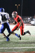 McPherson Bullpup Marcus Houghton (#1) rushes with the ball during the Winfield at McPherson football game that ended in a 47 to 8 victory for the Bullpups at the McPherson Stadium in McPherson, Kansas on September 28, 2012. (Photo: Joey Bahr, www.joeybahr.com)