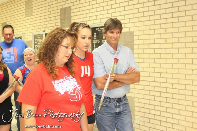 Ellinwood Lady Eagle Devann Patten (#14) lines up with her parents before the Central Plains Lady Oilers at Ellinwood Lady Eagles volleyball match at Ellinwood High School in Ellinwood, Kansas on October 11, 2012. (Photo: Joey Bahr, www.joeybahr.com)