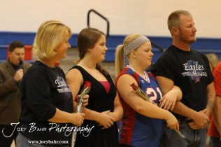 Ellinwood Lady Eagles Abby Watts (#21) and Shay Watts (team manager) is introduced with their parents before the Central Plains Lady Oilers at Ellinwood Lady Eagles volleyball match at Ellinwood High School in Ellinwood, Kansas on October 11, 2012. (Photo: Joey Bahr, www.joeybahr.com)