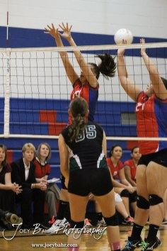 Ellinwood Lady Eagles Devann Patten (#14) and Kelsea Ward (#27) set a wall during the Central Plains Lady Oilers at Ellinwood Lady Eagles volleyball match at Ellinwood High School in Ellinwood, Kansas on October 11, 2012. (Photo: Joey Bahr, www.joeybahr.com)