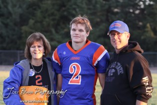 Otis-Bison Cougar Dylan Wissman (#2) stands with his parents before the Wilson High School at Otis-Bison High School Eight Man Division II District 7 matchup with Otis-Bison winning 60-14 in Otis, Kansas on October 19, 2012. (Photo: Joey Bahr, www.joeybahr.com)
