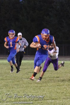 Otis-Bison Cougar Jordan Hoffman (#33) outruns Wilson Dragon Cole Zelenka (#1) during the Wilson High School at Otis-Bison High School Eight Man Division II District 7 matchup with Otis-Bison winning 60-14 in Otis, Kansas on October 19, 2012. (Photo: Joey Bahr, www.joeybahr.com)