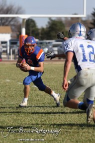 Otis-Bison Cougar Dylan Wissman (#2) carries the ball during the Thunder Ridge at Otis-Bison KSHSAA Eight Man Division II Regional Game with Thunder Ridge winning 28-18 at Otis-Bison High School in Otis, Kansas on November 3, 2012. (Photo: Joey Bahr, www.joeybahr.com)