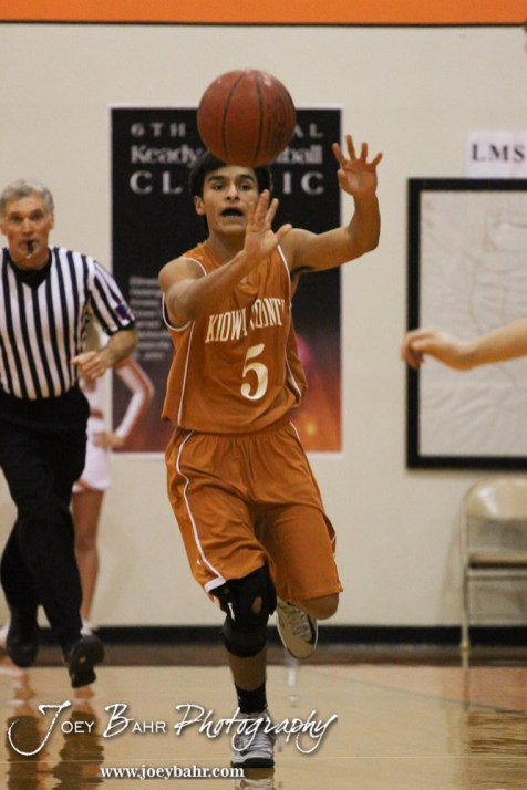 Kiowa County Maverick David Perez (#5) passes the ball down the court during the Larned Indians versus Kiowa County Mavericks First Round Game with Kiowa County winning 63 to 45 at the 6th Annual Keady Basketball Classic held at Larned Middle School in Larned, Kansas on December 3, 2012. (Photo: Joey Bahr, www.joeybahr.com)