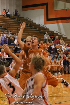 Kiowa County Maverick Caleb Davis (#4) watches a shot go towards the basket during the Larned Indians versus Kiowa County Mavericks First Round Game with Kiowa County winning 63 to 45 at the 6th Annual Keady Basketball Classic held at Larned Middle School in Larned, Kansas on December 3, 2012. (Photo: Joey Bahr, www.joeybahr.com)