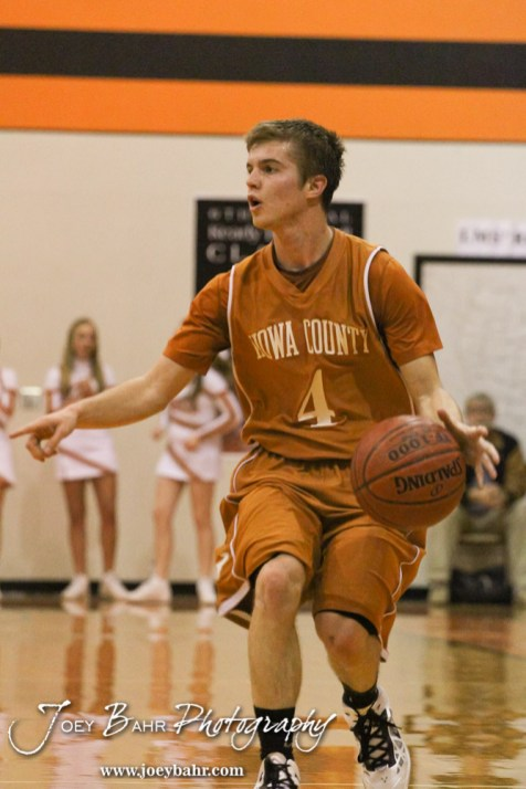 Kiowa County Maverick Caleb Davis (#4) dribbles down the court during the Larned Indians versus Kiowa County Mavericks First Round Game with Kiowa County winning 63 to 45 at the 6th Annual Keady Basketball Classic held at Larned Middle School in Larned, Kansas on December 3, 2012. (Photo: Joey Bahr, www.joeybahr.com)