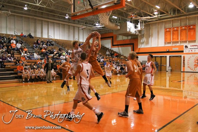 Larned Indians Grant Unruh (#4) and Brayden Smith (#3) try to pull the ball way from Kiowa County Maverick Rustin Ardery (#21) during the Larned Indians versus Kiowa County Mavericks First Round Game with Kiowa County winning 63 to 45 at the 6th Annual Keady Basketball Classic held at Larned Middle School in Larned, Kansas on December 3, 2012. (Photo: Joey Bahr, www.joeybahr.com)