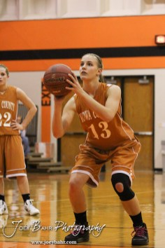 Kiowa County Lady Maverick Heather Melton (#13) shoots a free throw attempt during the Larned Lady Indians versus Kiowa County Lady Mavericks First Round Game with Larned winning 50 to 39 at the 6th Annual Keady Basketball Classic held at Larned Middle School in Larned, Kansas on December 3, 2012. (Photo: Joey Bahr, www.joeybahr.com)