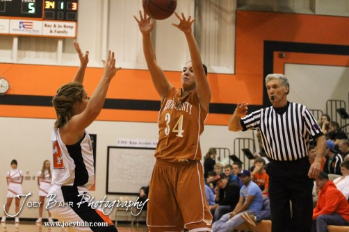 Kiowa County Lady Maverick Dena Liggett (#34) throws an inbounds pass during the Larned Lady Indians versus Kiowa County Lady Mavericks First Round Game with Larned winning 50 to 39 at the 6th Annual Keady Basketball Classic held at Larned Middle School in Larned, Kansas on December 3, 2012. (Photo: Joey Bahr, www.joeybahr.com)