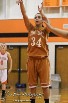 Kiowa County Lady Maverick Dena Liggett (#34) shoots a free throw attempt during the Larned Lady Indians versus Kiowa County Lady Mavericks First Round Game with Larned winning 50 to 39 at the 6th Annual Keady Basketball Classic held at Larned Middle School in Larned, Kansas on December 3, 2012. (Photo: Joey Bahr, www.joeybahr.com)