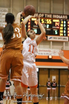 Kiowa County Lady Maverick Angela Liggett (#33) blocks the shot of Larned Lady Indian Reagan Quick (#11) during the Larned Lady Indians versus Kiowa County Lady Mavericks First Round Game with Larned winning 50 to 39 at the 6th Annual Keady Basketball Classic held at Larned Middle School in Larned, Kansas on December 3, 2012. (Photo: Joey Bahr, www.joeybahr.com)