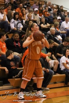 Kiowa County Lady Maverick Katelynn Gamble (#0) throws the ball into play during the Larned Lady Indians versus Kiowa County Lady Mavericks First Round Game with Larned winning 50 to 39 at the 6th Annual Keady Basketball Classic held at Larned Middle School in Larned, Kansas on December 3, 2012. (Photo: Joey Bahr, www.joeybahr.com)