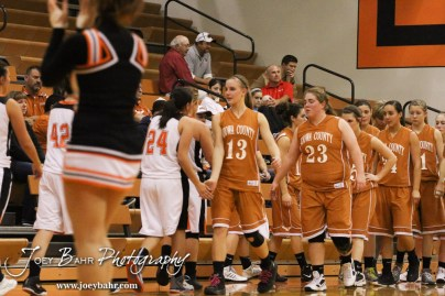 Members of the Larned Lady Indians and Kiowa County Lady Mavericks shake hands after the Larned Lady Indians versus Kiowa County Lady Mavericks First Round Game with Larned winning 50 to 39 at the 6th Annual Keady Basketball Classic held at Larned Middle School in Larned, Kansas on December 3, 2012. (Photo: Joey Bahr, www.joeybahr.com)