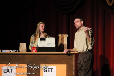 """Kansas played by Kaylan Lagerman and Sandy played by Doug Simmons talk during the Great Bend Community Theater's final rehearsal of """"Duck Hunter Shoots Angel"""" by Mitch Albom at Crest Theater in Great Bend, Kansas on April 17, 2013. (Photo: Joey Bahr, www.joeybahr.com)"""