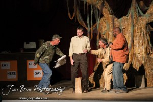 """Duane played by K.B. Bell chases Duwell played by Charlie Dixon around Sandy played by Doug Simmons and Lenny played by C.T. Taylor during the Great Bend Community Theater's final rehearsal of """"Duck Hunter Shoots Angel"""" by Mitch Albom at Crest Theater in Great Bend, Kansas on April 17, 2013. (Photo: Joey Bahr, www.joeybahr.com)"""