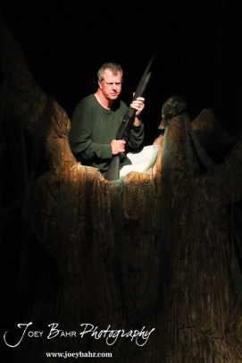 """Duwell played by Charlie Dixon sits in a tree during the Great Bend Community Theater's final rehearsal of """"Duck Hunter Shoots Angel"""" by Mitch Albom at Crest Theater in Great Bend, Kansas on April 17, 2013. (Photo: Joey Bahr, www.joeybahr.com)"""