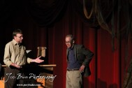 """Sandy played by Doug Simmons talks with Voice/Loan Officer played by John O'Connor during the Great Bend Community Theater's final rehearsal of """"Duck Hunter Shoots Angel"""" by Mitch Albom at Crest Theater in Great Bend, Kansas on April 17, 2013. (Photo: Joey Bahr, www.joeybahr.com)"""