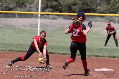 Great Bend Lady Panther McKenna Mauler (#22) runs to second as Liberal Lady Redskin Cynthia Cisneros (#5) fields the ball during the Liberal Lady Redskins at Great Bend Lady Panthers Softball Double Header with Great Bend winning both games 18-0 (3 innings) 13-0 at Barton Community College Softball Field in Great Bend, Kansas on April 27, 2013. (Photo: Joey Bahr, www.joeybahr.com)