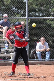 A Great Bend Lady Panther hits the ball during the Liberal Lady Redskins at Great Bend Lady Panthers Softball Double Header with Great Bend winning both games 18-0 (3 innings) 13-0 at Barton Community College Softball Field in Great Bend, Kansas on April 27, 2013. (Photo: Joey Bahr, www.joeybahr.com)