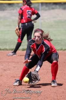 A Great Bend Lady Panther fields a ball as part of warmups during the Liberal Lady Redskins at Great Bend Lady Panthers Softball Double Header with Great Bend winning both games 18-0 (3 innings) 13-0 at Barton Community College Softball Field in Great Bend, Kansas on April 27, 2013. (Photo: Joey Bahr, www.joeybahr.com)