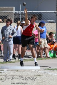 A Hoxie thrower competes in the shot put during the 2013 KSHSAA Class 1A Regional Track and Field competition at Lewis Field on the campus of Fort Hays State University in Hays, Kansas on May 17, 2013. (Photo: Joey Bahr, www.joeybahr.com)