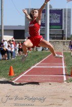 A Greeley County competitor flies through the air in the long jump during the 2013 KSHSAA Class 1A Regional Track and Field competition at Lewis Field on the campus of Fort Hays State University in Hays, Kansas on May 17, 2013. (Photo: Joey Bahr, www.joeybahr.com)