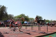 Girls jump over the first hurdle in the 100 Meter Hurdle Preliminaries during the 2013 KSHSAA Class 1A Regional Track and Field competition at Lewis Field on the campus of Fort Hays State University in Hays, Kansas on May 17, 2013. (Photo: Joey Bahr, www.joeybahr.com)