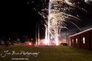 Fireworks light up the sky as they are pushed north by the wind during the Olmitz City Fireworks Celebration at the Knights of Columbus Council #2100 Hall in Olmitz, Kansas on July 6, 2013. (Photo: Joey Bahr, www.joeybahr.com)