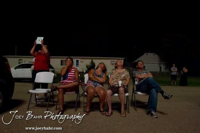 Past and present community members watch the display during the Olmitz City Fireworks Celebration at the Knights of Columbus Council #2100 Hall in Olmitz, Kansas on July 6, 2013. (Photo: Joey Bahr, www.joeybahr.com)