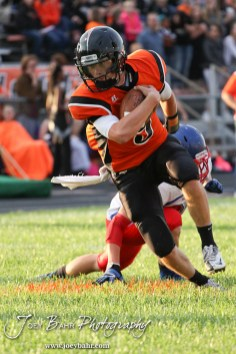 Larned Indian Easton Palmer (#9) evades an Ellinwood Eagle tackler during the Ellinwood versus Larned High School football game with the Larned Indians winning 60 to 0 at Larned High School in Larned, Kansas on September 13, 2013. (Photo: Joey Bahr, www.joeybahr.com)